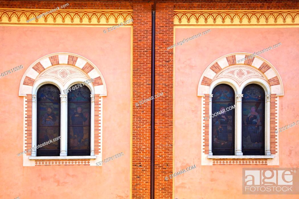 Stock Photo: abbiate varese rose window church italy the old wall terrace church bell tower.