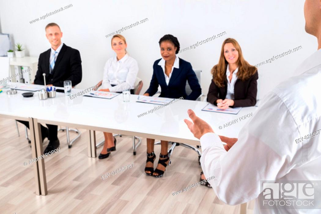 Stock Photo: Businessperson Having Discussion With Colleague In Office.