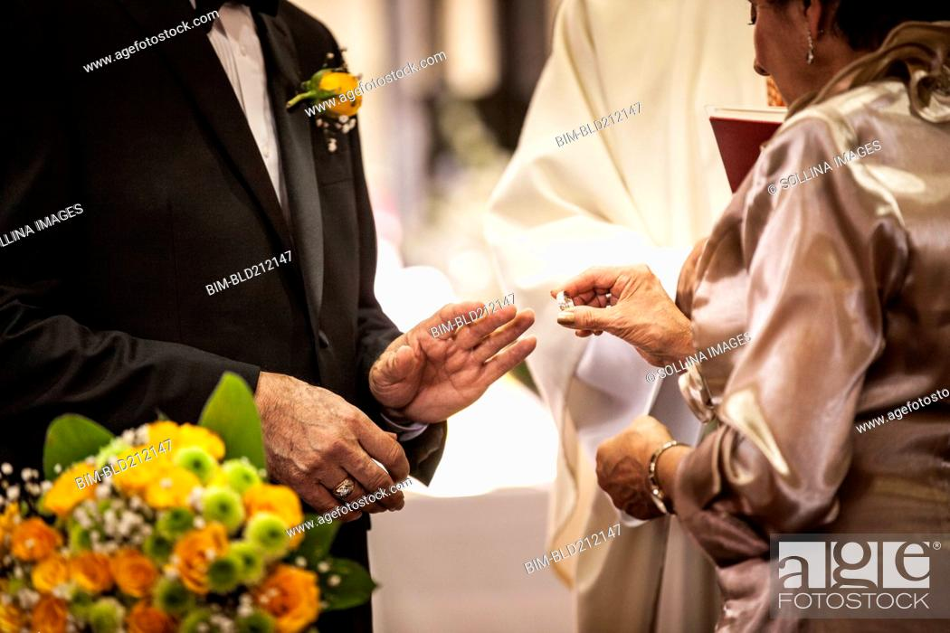 Stock Photo: Senior couple exchanging rings at wedding.