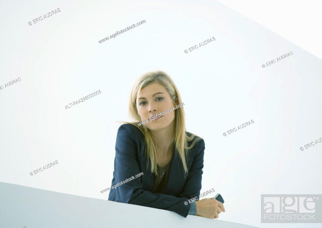 Stock Photo: Businesswoman holding cell phone.
