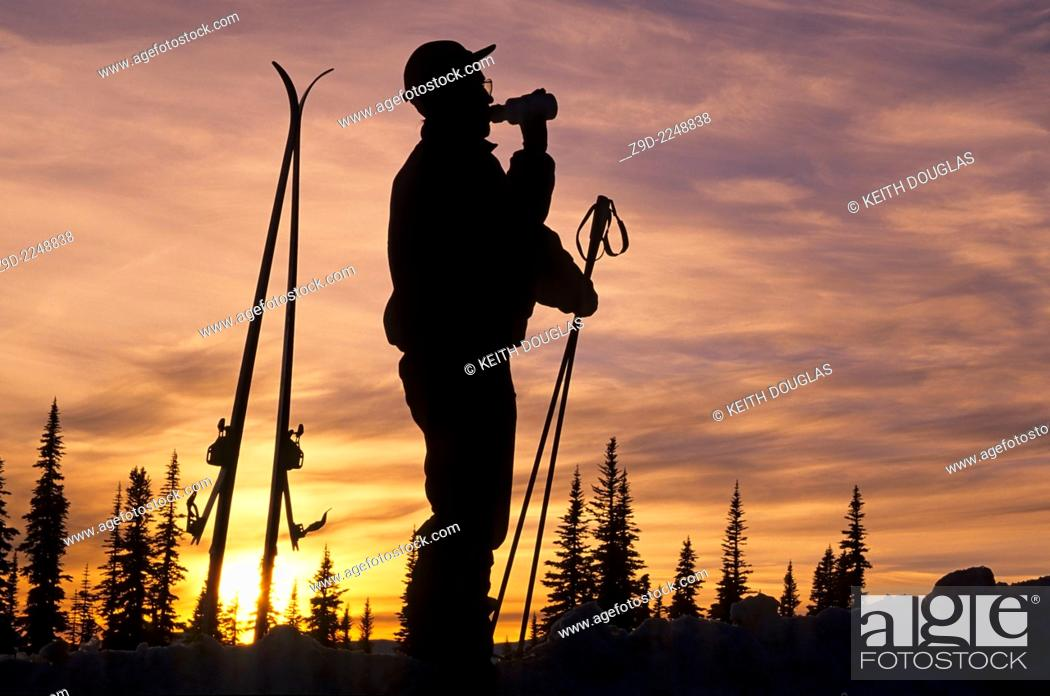 Stock Photo: Backcountry skier silhouette at sunset, Hudson Bay Mountain, Smithers, British Columbia.