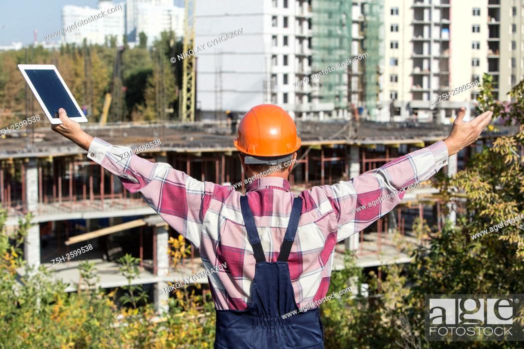 Stock Photo: Russian Federation. Belgorod. Builder-installer working.