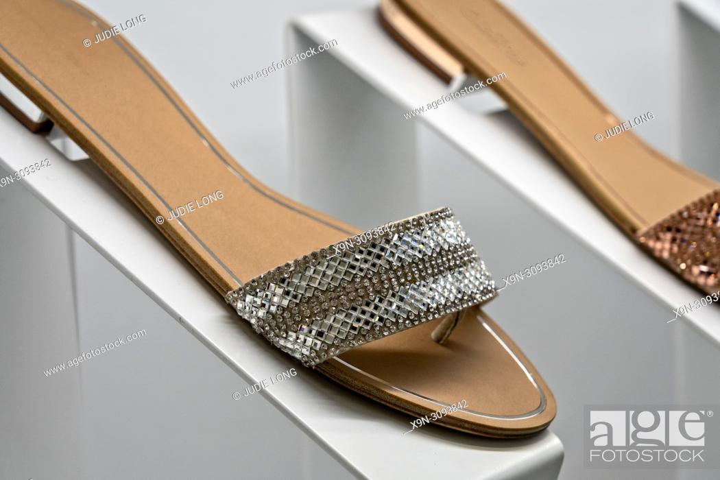 Stock Photo: NYC Store Display of Flat Heeled Womens Casual Shoes.