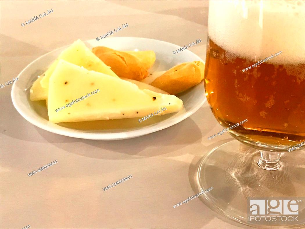 Stock Photo: Glass of beer with cheese. Close view.