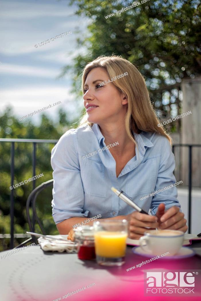 Stock Photo: Portrait of woman, working at cafe table, outdoors.