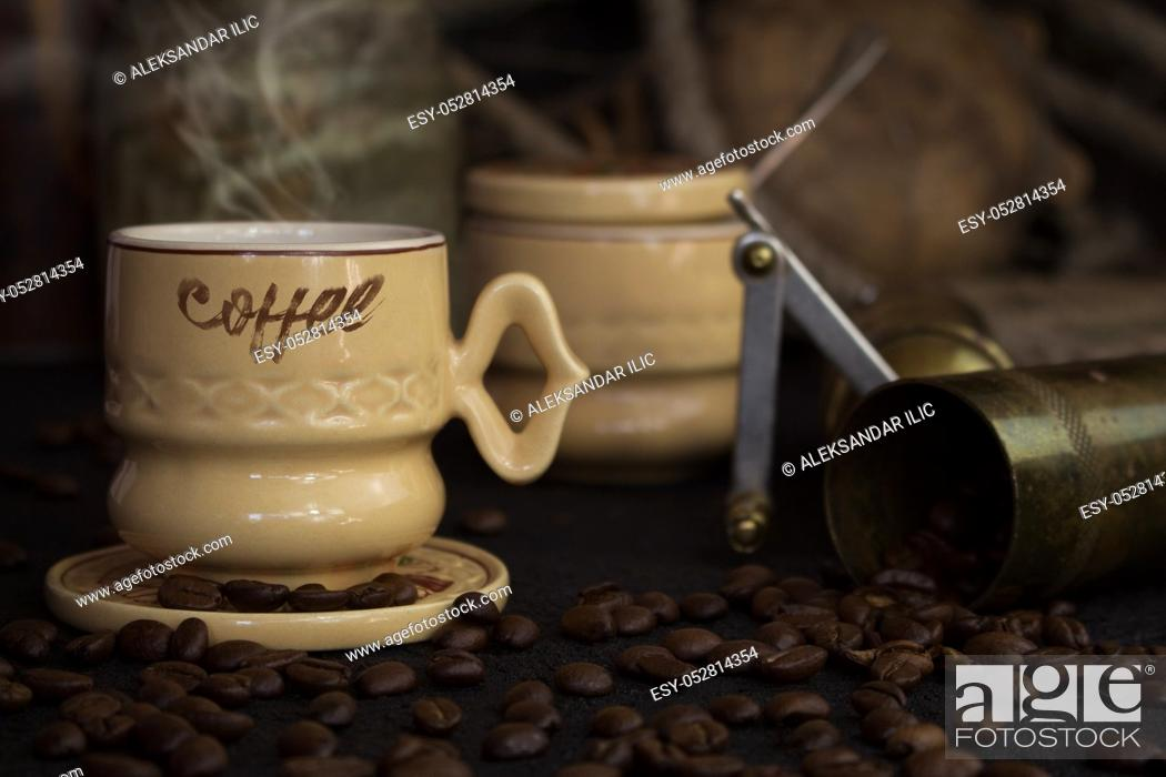 Stock Photo: Vintage Coffee Cup, Pot, Grinder With Coffee Beans On a Rustic Wooden Surface.