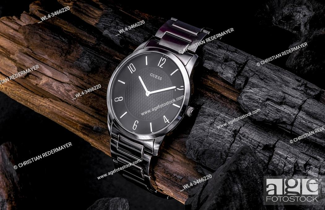 Stock Photo: life style watch on grunge and burned wood log.
