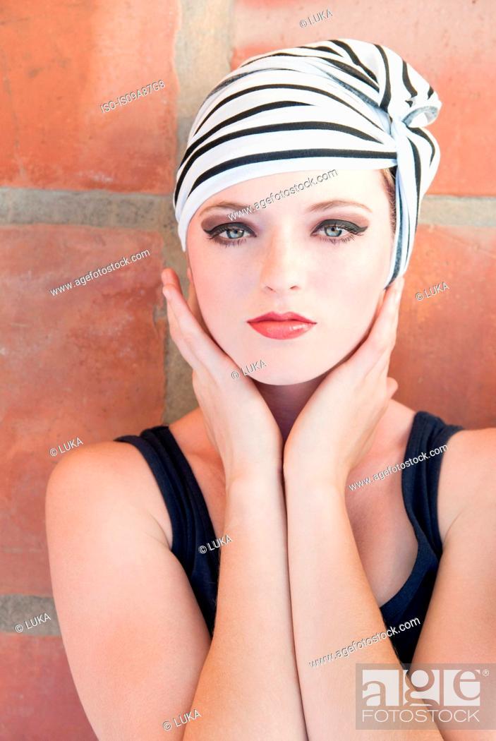 Stock Photo: Girl wearing striped turban.