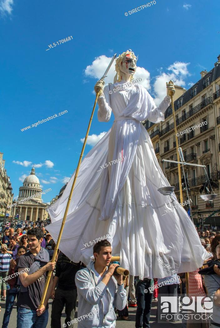 Stock Photo: Paris, France, French Street Theatre Group, Holding huge Statue, Outside on Street During Annual May Day Events,.