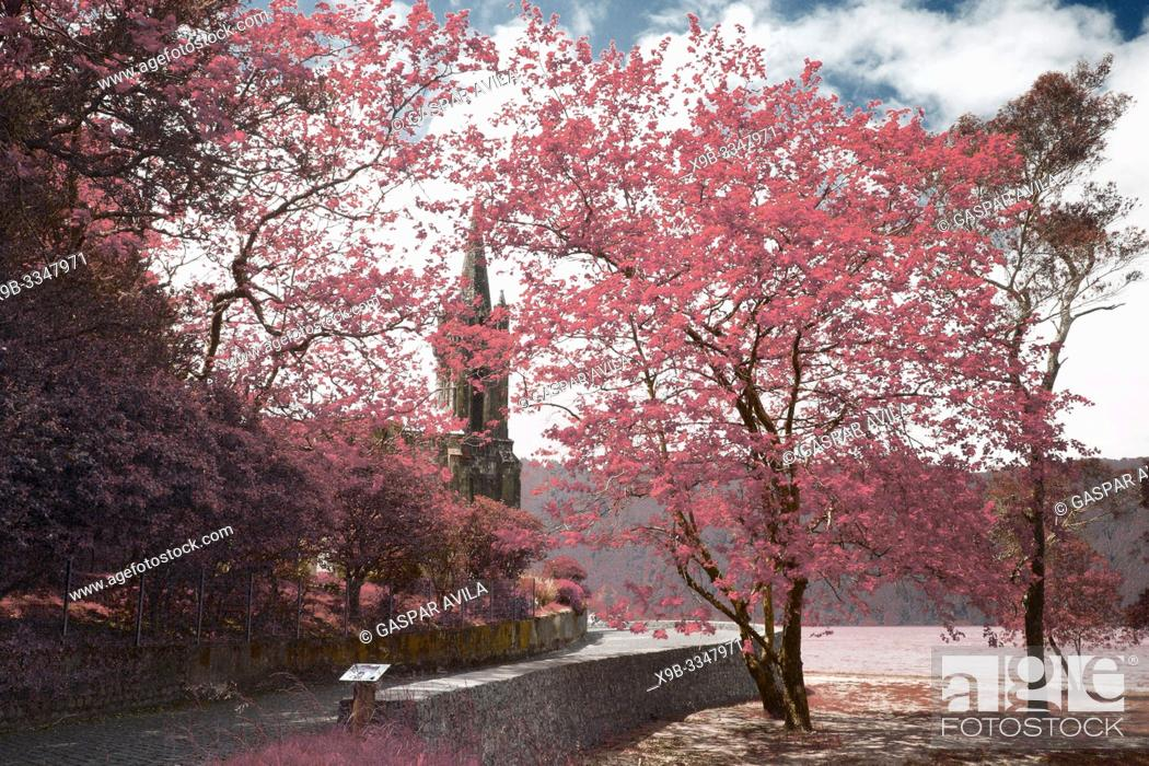 Stock Photo: Simulated infrared photo of trees and gothic style chapel on the shore of Furnas lake. Sao Miguel, Azores islands, Portugal.