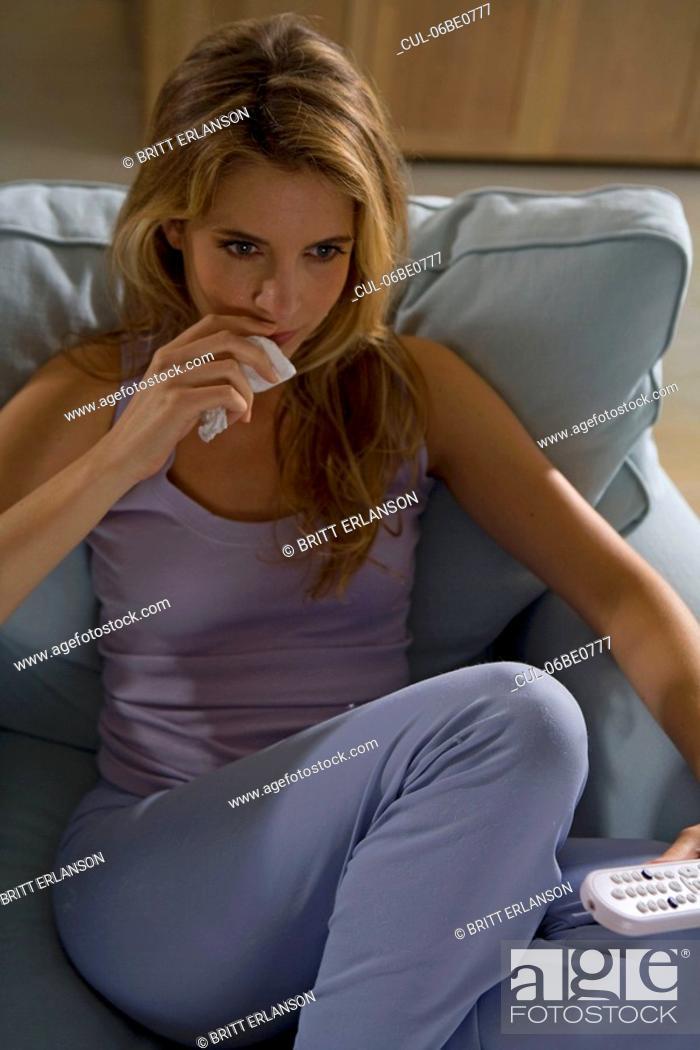 Stock Photo: Woman sitting, watching tv.