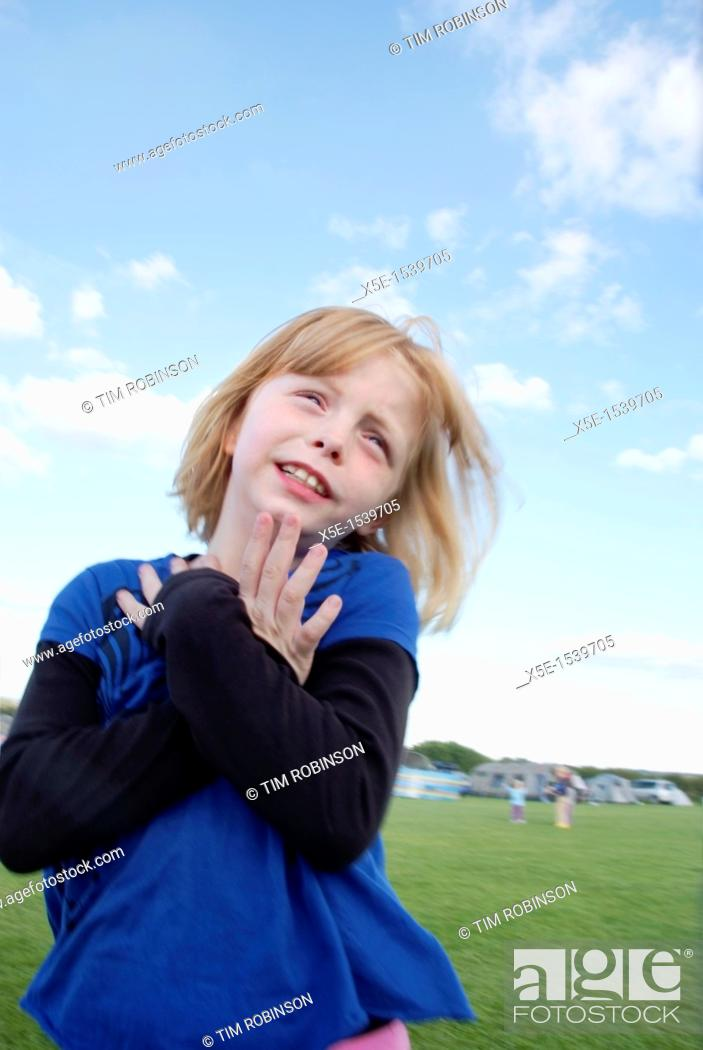 Stock Photo: 8 year girl making faces to camera.