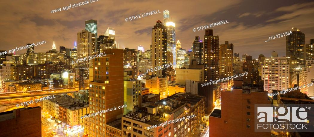 Stock Photo: East side skyline at 62nd St., (looking west) at night, New York City, USA.