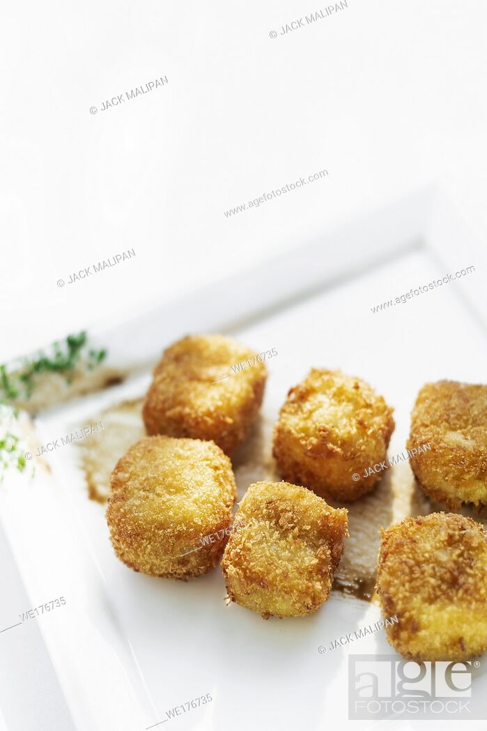Stock Photo: fried mashed potato square croquettes simple vegetarian side dish on white plate.