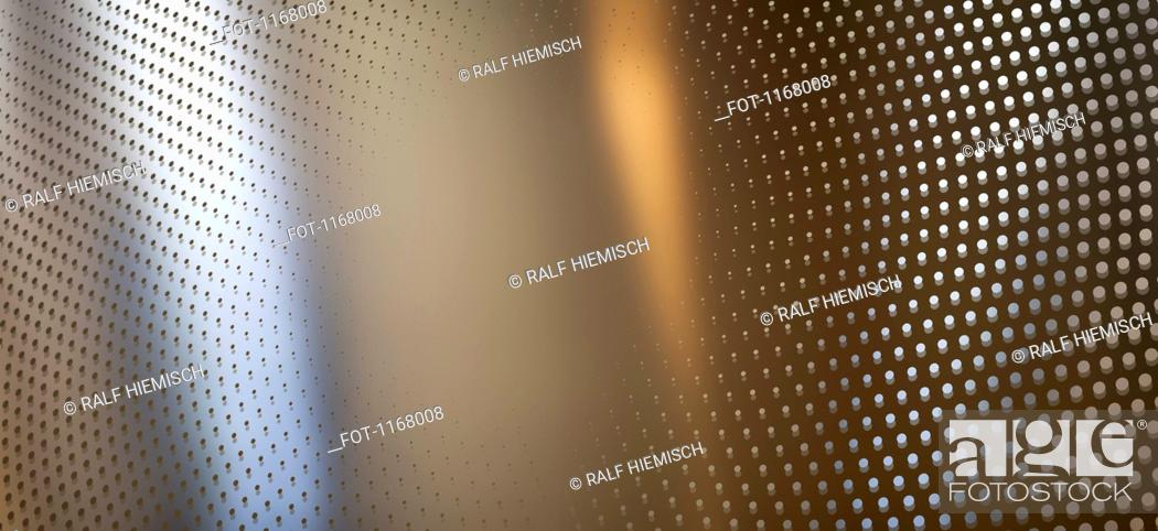 Stock Photo: Round dot pattern against an abstract background.