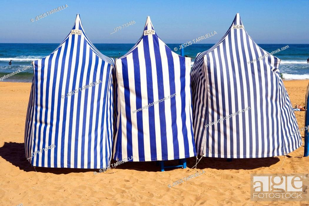 Stock Photo: Booths shade on the beach. Spain, Basque Country, province of Guipuzcoa, Zarautz.