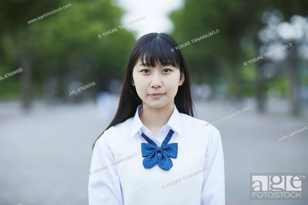 Stock Photo: Japanese high school student in uniform downtown Tokyo.