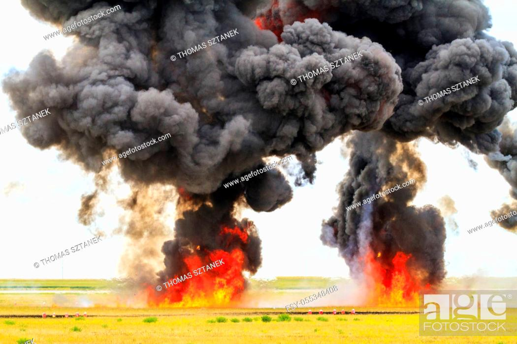 Stock Photo: Large fireball with black smoke.