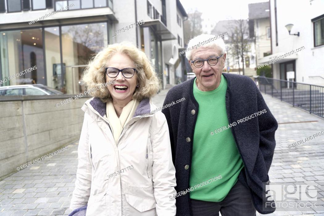 Stock Photo: Senior couple walking together, Starnberg, Bavaria, Germany.