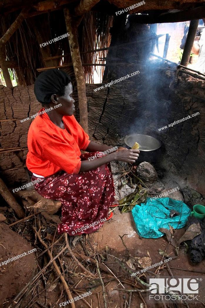 Stock Photo: woman food fire women uganda method cooking open.