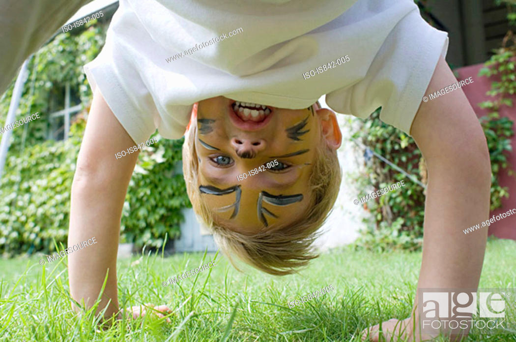 Stock Photo: Boy playing in garden.