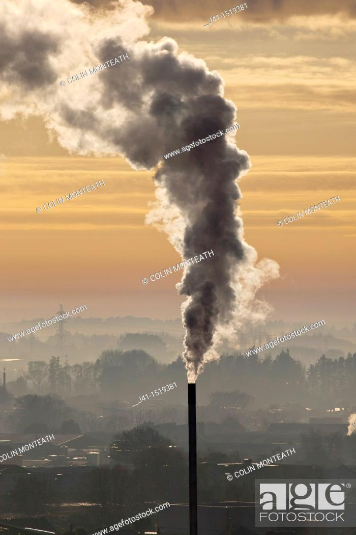 Stock Photo: Chimney spews smoke, winter dawn from Port Hills, Christchurch, Canterbury, South Island, New Zealand.