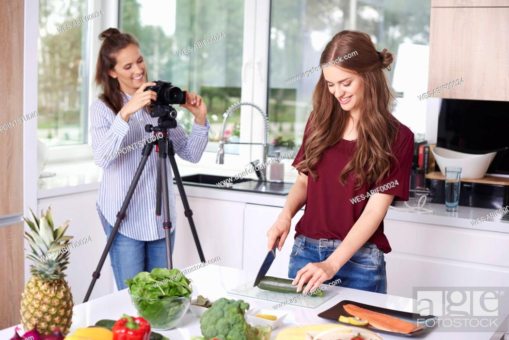 Stock Photo: Women recording video for their food blog.