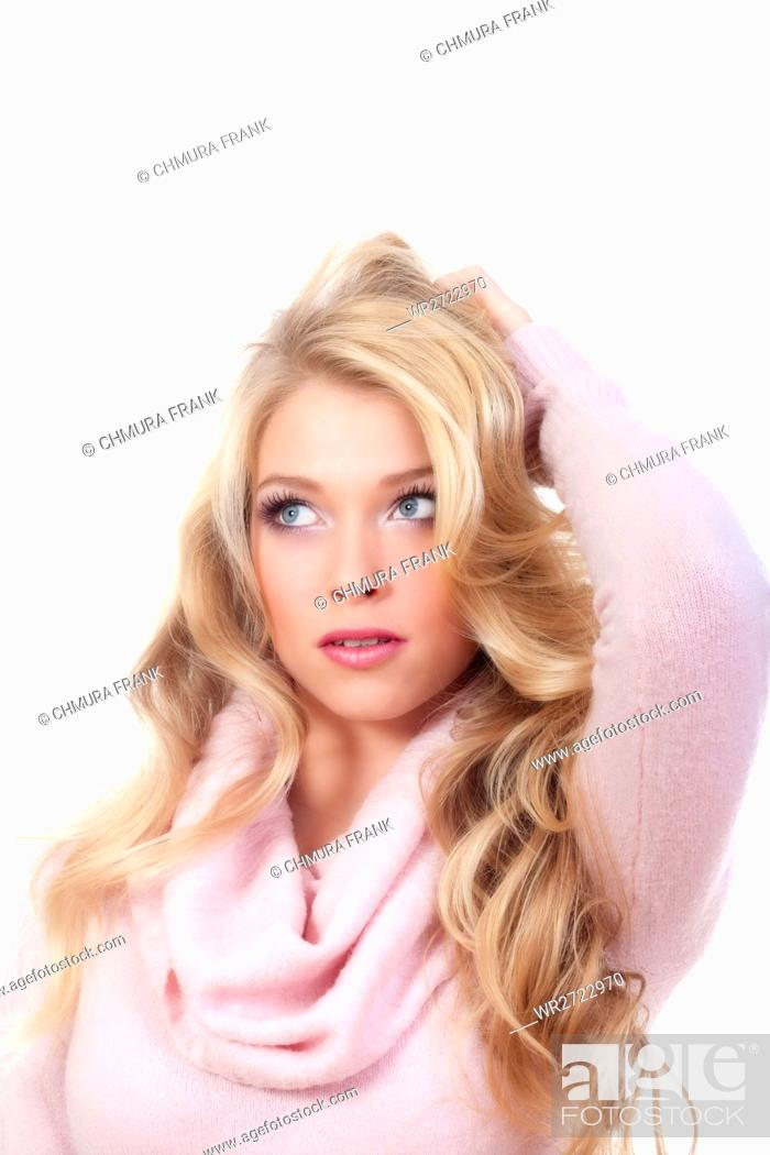 Stock Photo: beautiful young blond woman standing, looking - isolated on white.