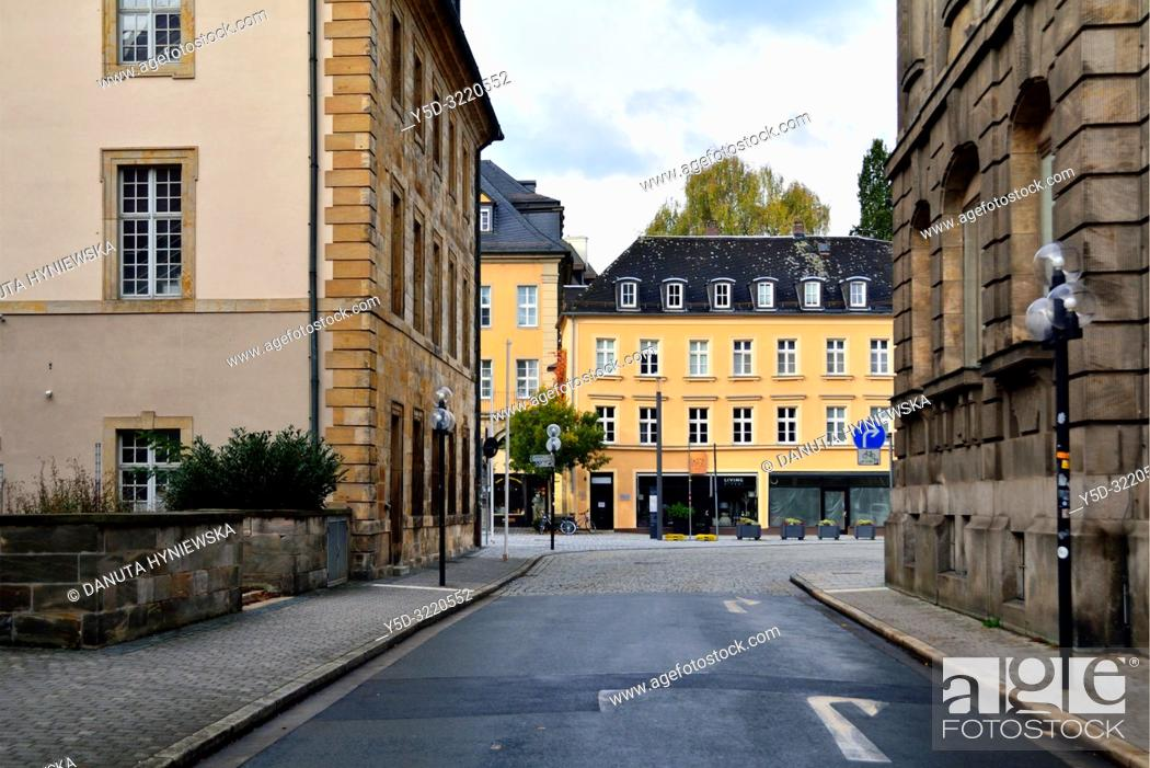 Stock Photo: Munzgasse street next to Margravial Opera House (on left) and Iwalewahaus on right, in front historic building along Opernstrasse, old town of Bayreuth.