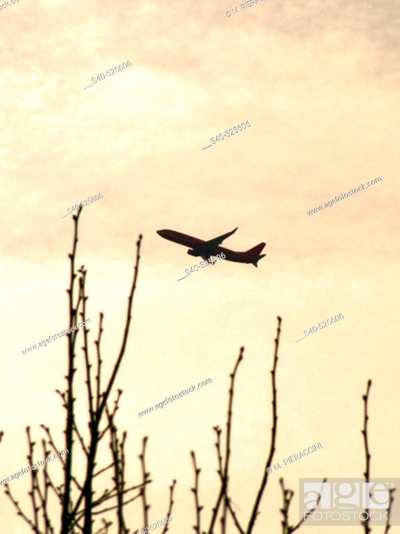 Stock Photo: Silhouette of an airplane in the sky.