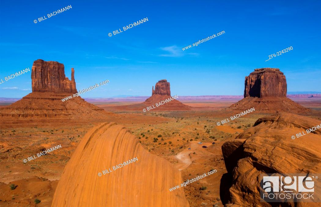Stock Photo: Monument Valley Utah desert mittens in panoramic of Western landscape at sunset Natioanal Park.