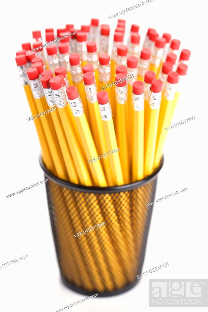 Stock Photo: Group of pencils in a pencil holder with eraser ends up.