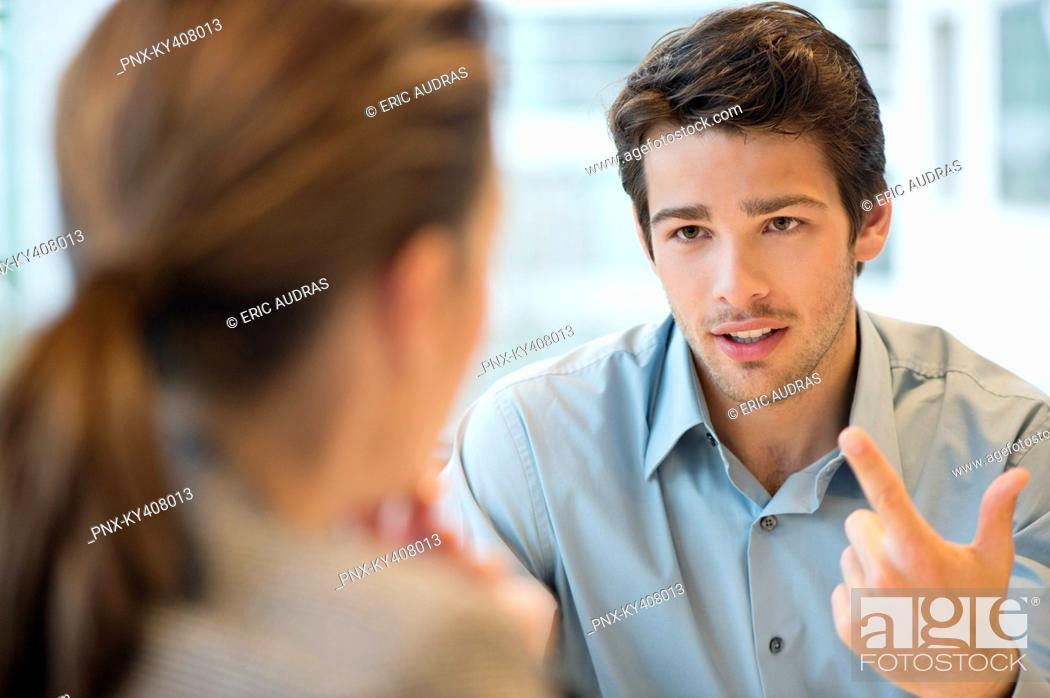 Stock Photo: Business executive discussing with her client.