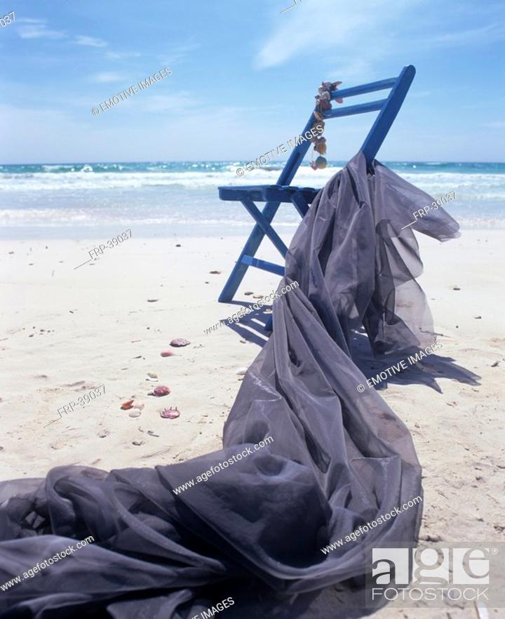 Stock Photo: Chair and blue cloth on the beach.