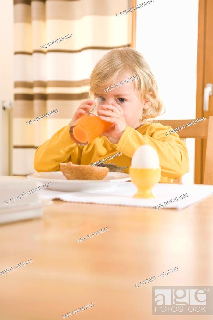 Stock Photo: Girl drinking juice in breakfast.