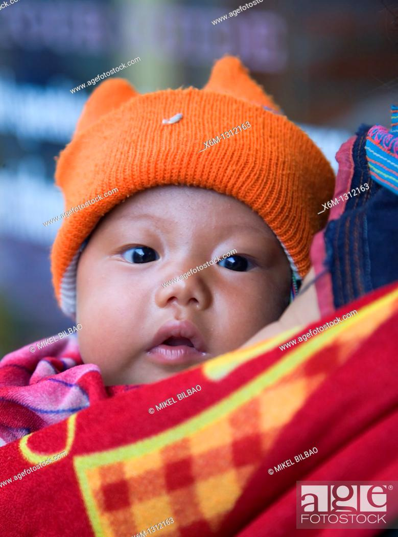 Stock Photo: black hmong ethnic baby  Sapa, Lao Cai province, Vietnam.