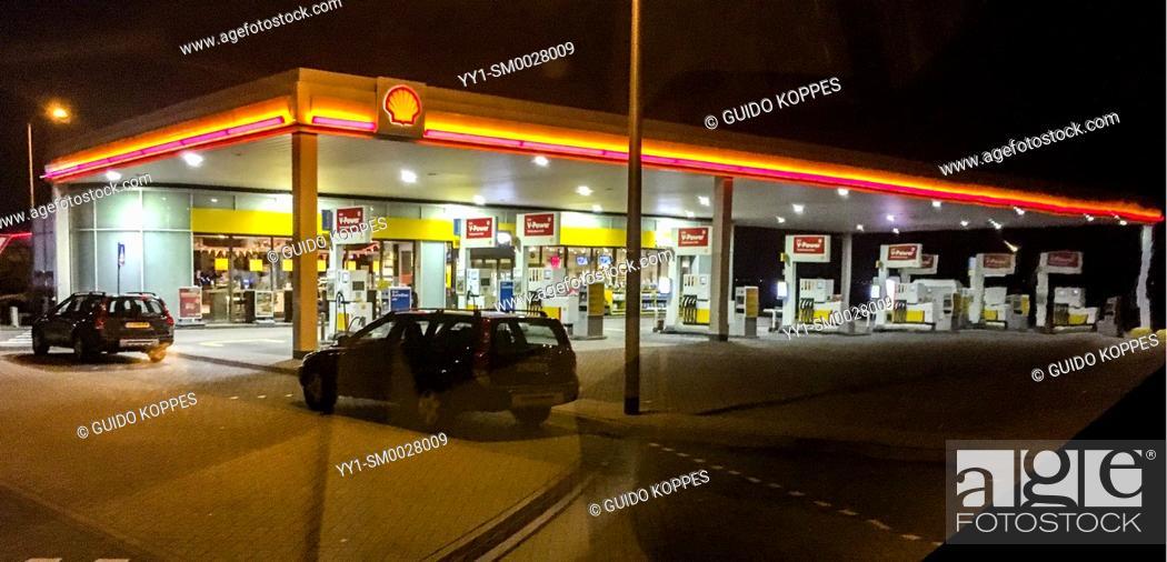 Stock Photo: Noord-Brabant, Netherlands. Gas & Fuel Station Alonside Highway at Night.