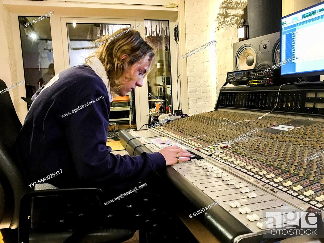 Imagen: Berlin, Germany. Music student Lucas working on his skills inside a professional music studio.