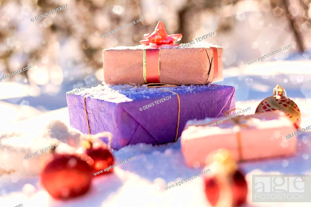 Stock Photo: Christmas gifts and ornaments in snow.