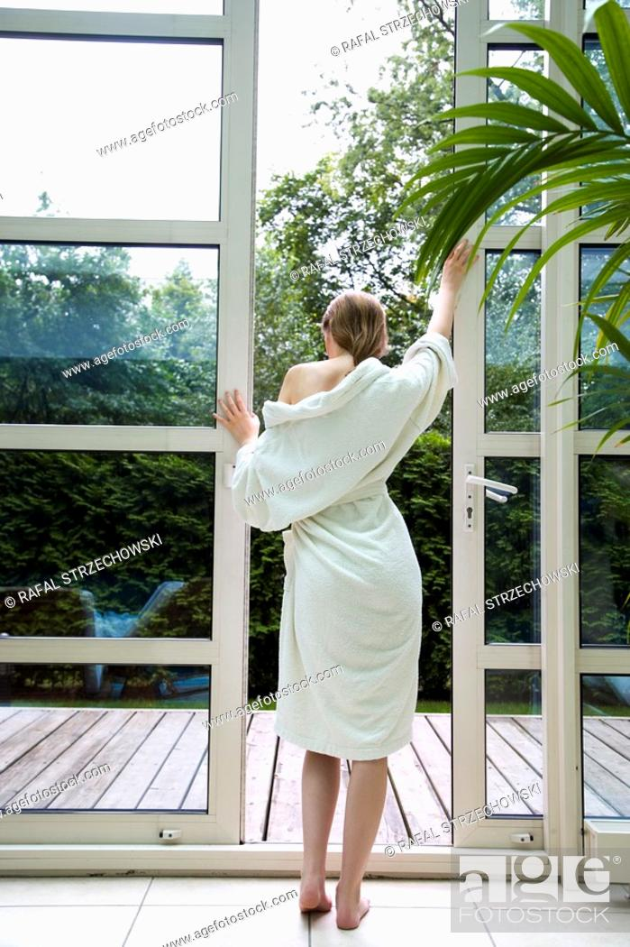 Stock Photo: Young woman on terrace.