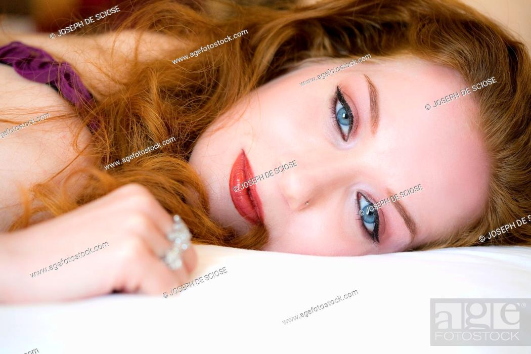 Stock Photo: Portrait of a 28 year old redheaded woman.