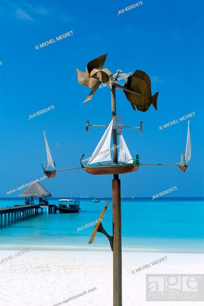 Stock Photo: Maldives - Dunikolu Island - Coco Palm Resort - Weathercock.