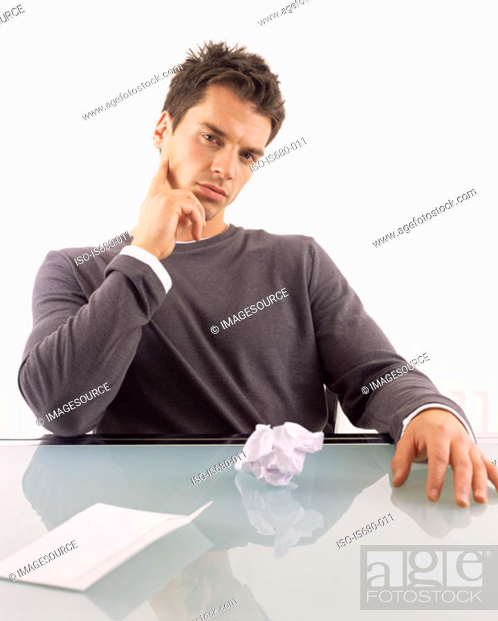 Stock Photo: Man with envelope and crumpled letter.