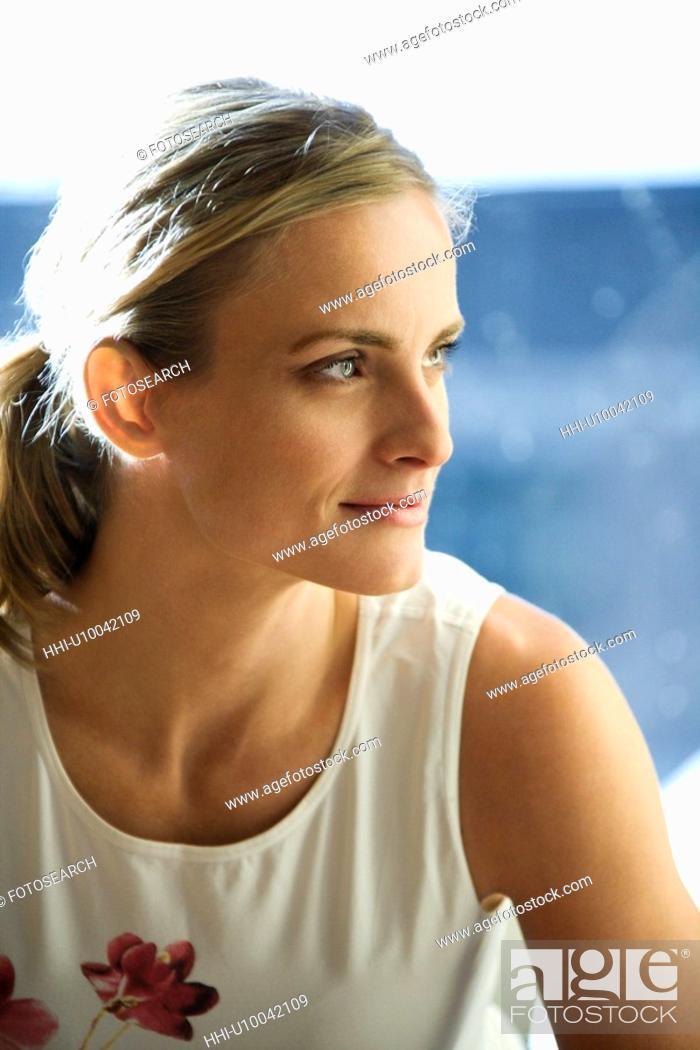Stock Photo: Portrait of prime Caucasian female adult at gym.