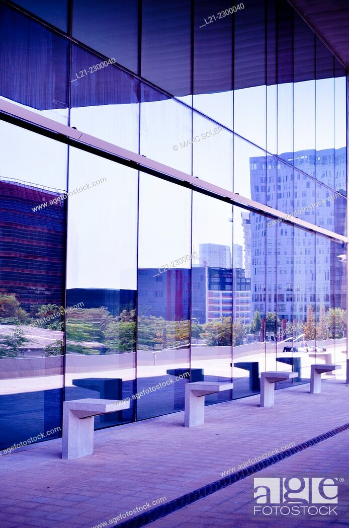 Stock Photo: Benches. Buildings reflected in the glass. @22 district, Barcelona, Catalonia, Spain.