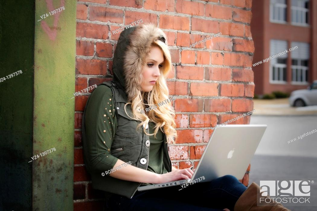 Stock Photo: Female student with a laptop studying.