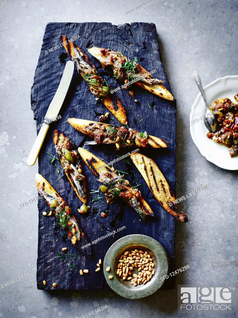 Stock Photo: Quick sweet and sour anchovies on toast.