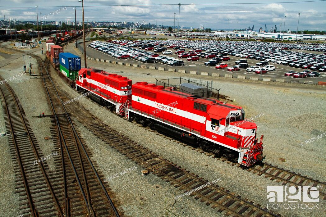 Stock Photo: Tacoma Rail locomotives pulling a string of containers in the yard in the Port of Tacoma.
