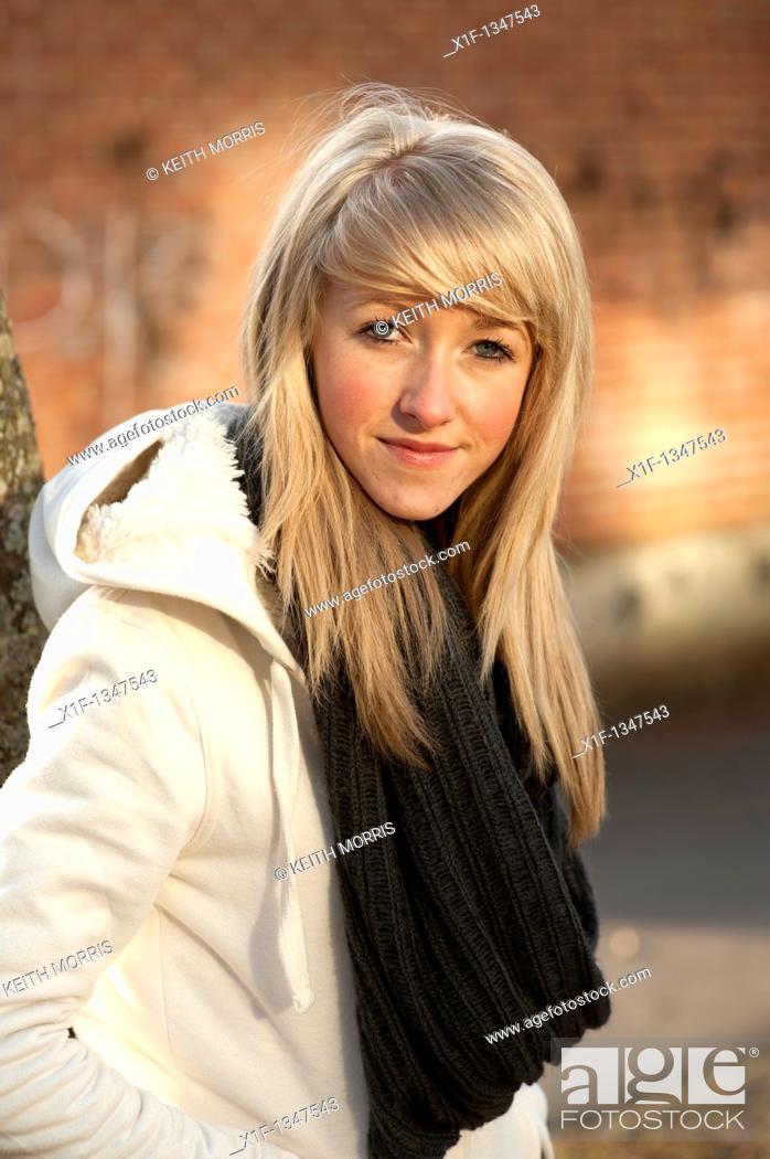 Stock Photo: A slim blonde 14 year old teenage girl, UK.