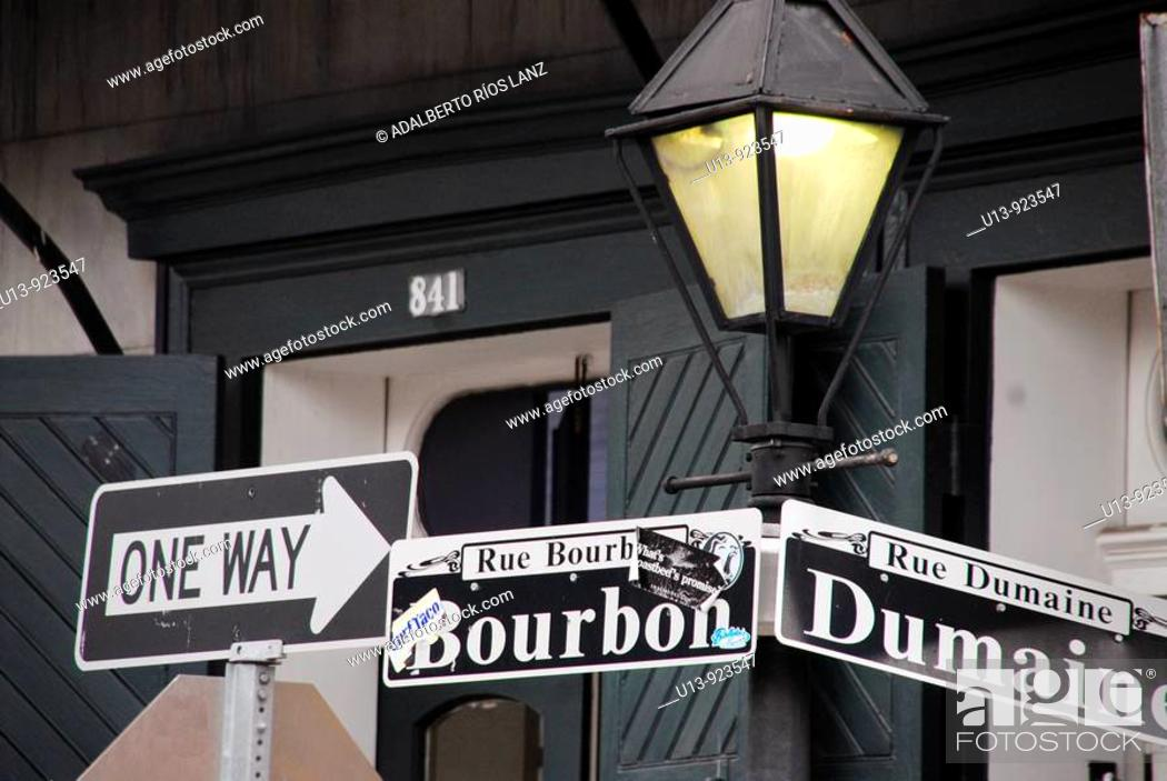 Stock Photo: Lamp, lantern and sign at Bourbon and Dumaine Street corner, French Quarter, New Orleans, Louisiana, USA.